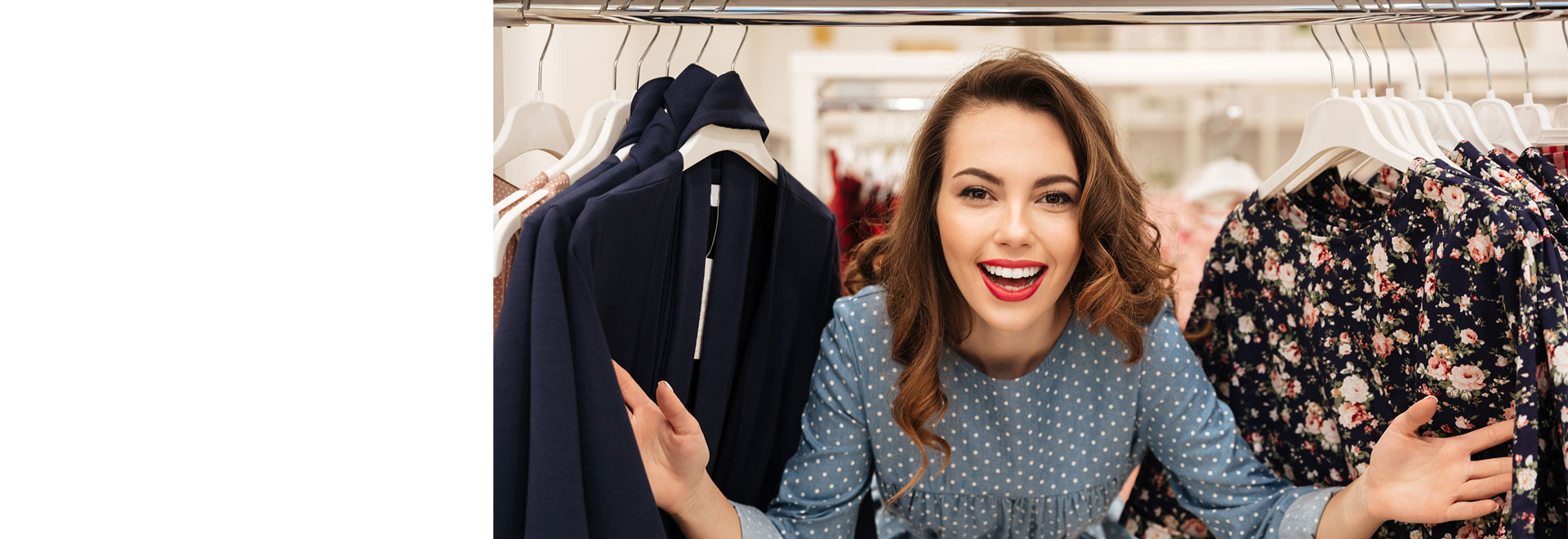 Lady appearing through clothes rail