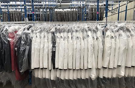 Moose Knuckles garments on hangers