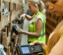 Warehouse worker scanning stock